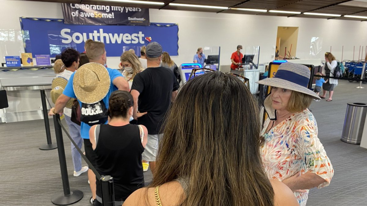 Customers line up at the Southwest Airlines station at the Colorado Springs Airport on June 15,...