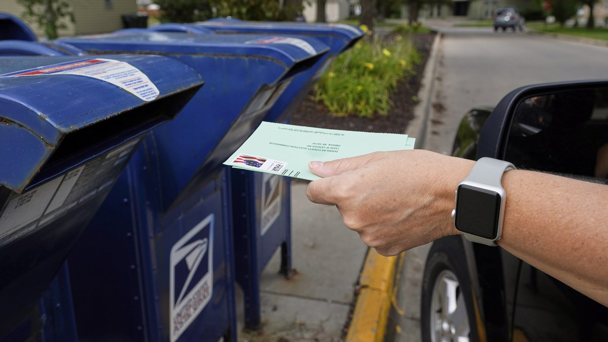 FILE - In this Tuesday, Aug. 18, 2020 file photo, a person drops applications for...
