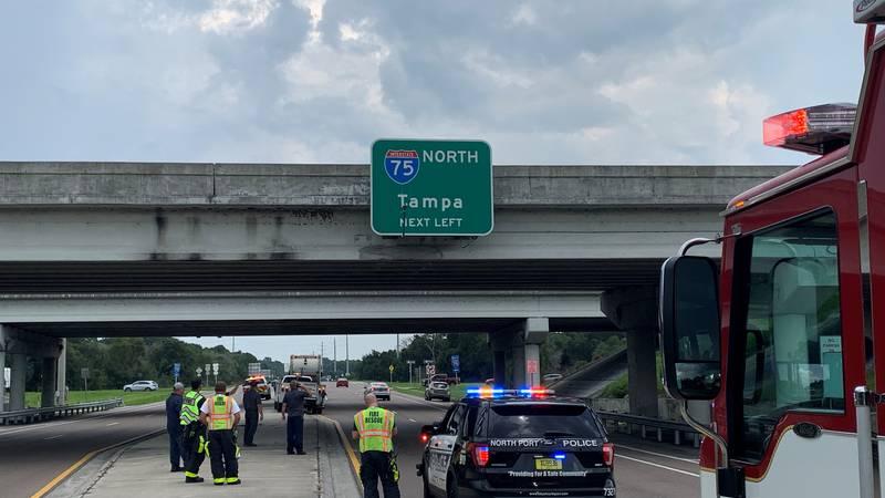 City garbage truck struck I-75 overpass on Toledo Blade Blvd.