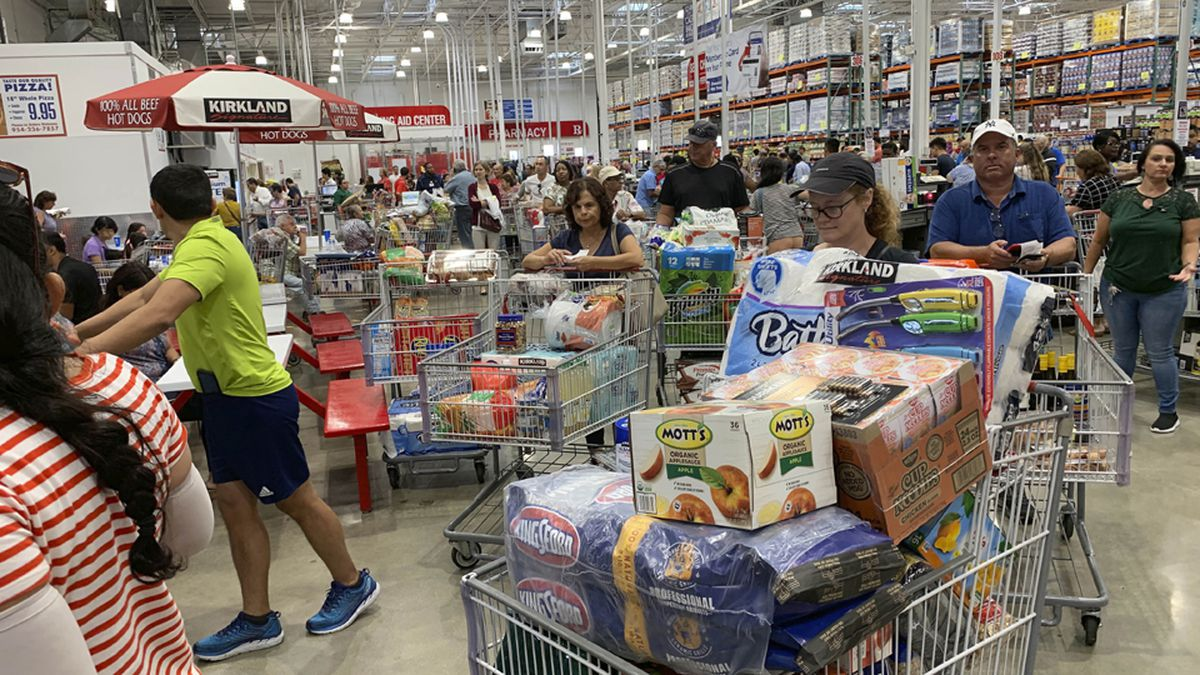 Shoppers wait in long lines at Costco, Thursday, Aug. 29, 2019, in Davie, Fla., as they stock...
