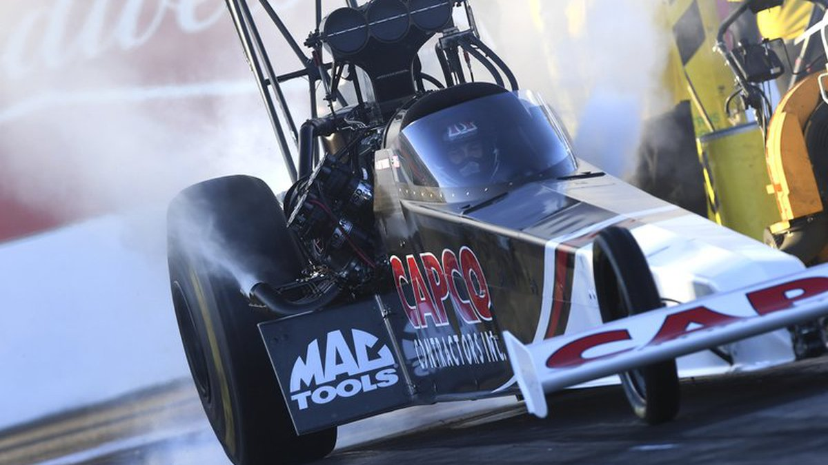 In this photo provided by the NHRA, Billy Torrence drives in Top Fuel qualifying Saturday, Feb....