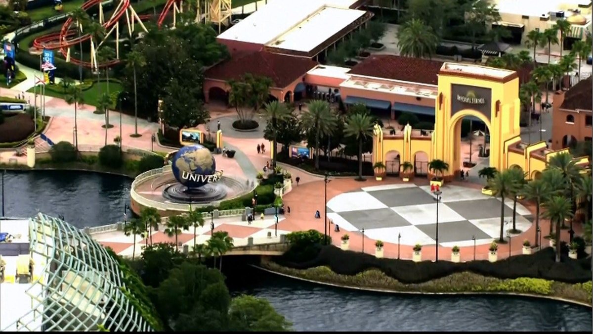 Universal Studios' theme park in Orlando will reopen Friday. Guests will be required to wear...