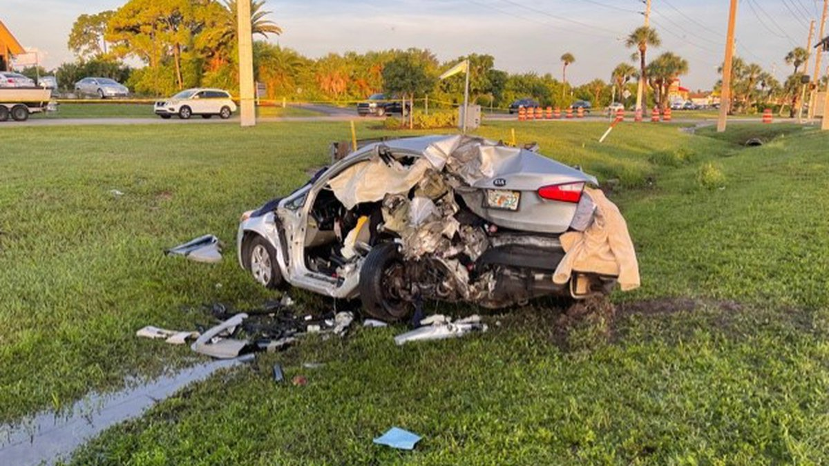 A woman died in a two-car crash early Monday morning