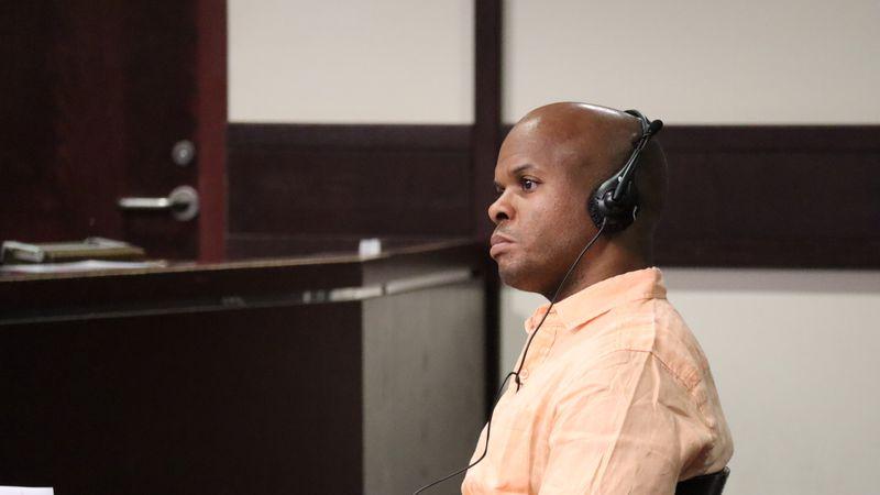 Yuniel Sentmanat-Gonzalez listens during his murder trial in Tampa.