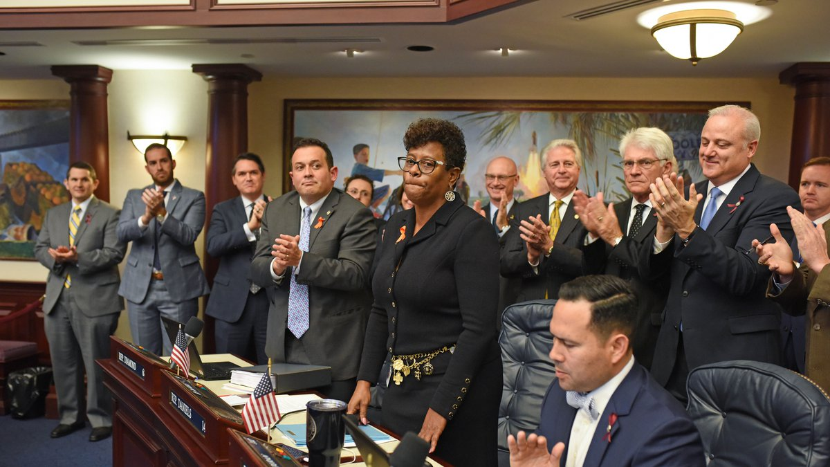 Kimberly Daniels applauded by her colleagues during a session of the Florida House of...