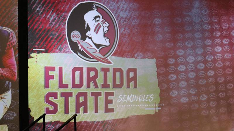 Florida State's logo dons a wall in Charlotte during ACC Kickoff.