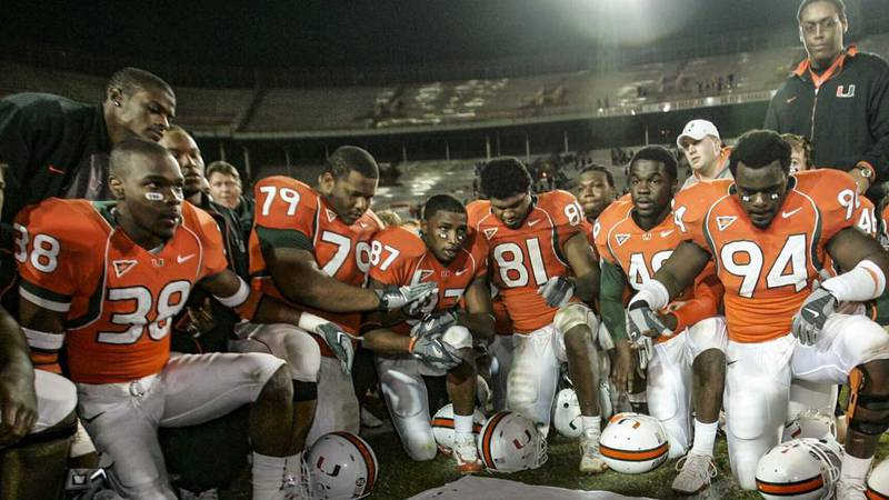 In this Nov. 23, 2006, file photo, Miami players, including Rashaun Jones (38) at left, pay...