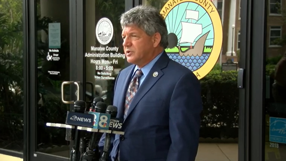 Manatee County Administrator Scott Hopes holds a briefing recently outside the county...