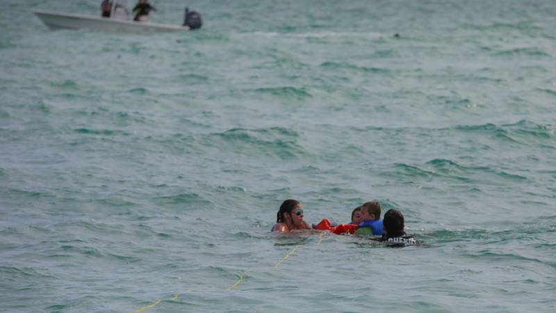 Deputies helped pull two boaters and three children from the water off Anna Maria Island.