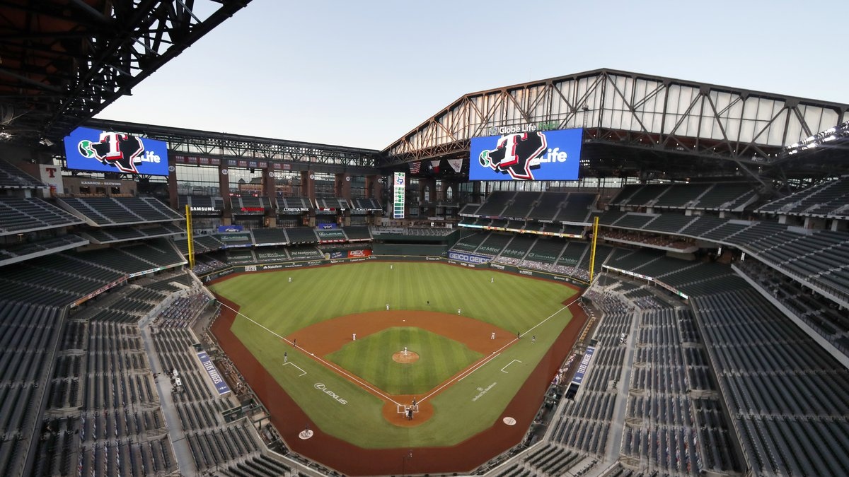 FILE - The Seattle Mariners play the Texas Rangers in the first inning of a baseball game at...