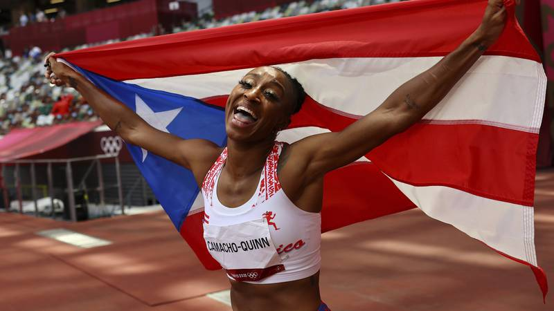 Jasmine Camacho-Quinn, of Puerto Rico celebrates after winning the gold in the women's...