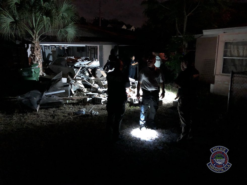 Police are investigating after a vehicle crashed through a Sarasota home. The driver was found...