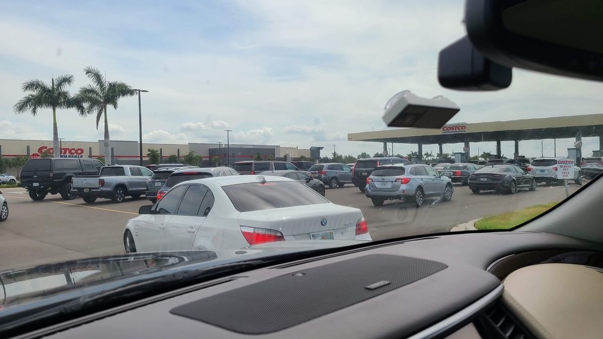 Cars line up for fuel at the Costco on State Road 64 in Manatee County Wednesday.