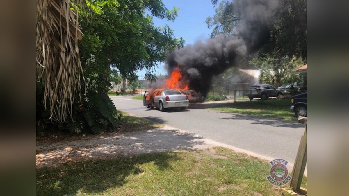 Police assisting with putting out active car fire on Gull Lane in Sarasota