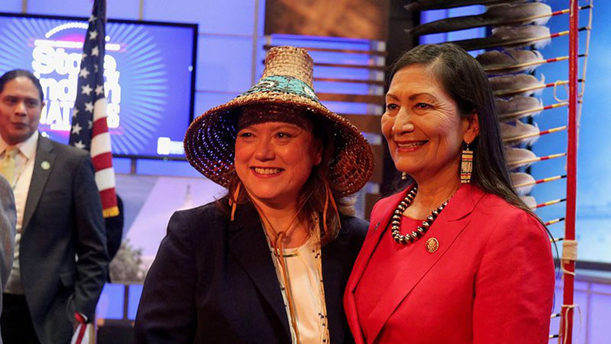 National Congress of American Indians President Fawn Sharp, left, posing in February with Rep....