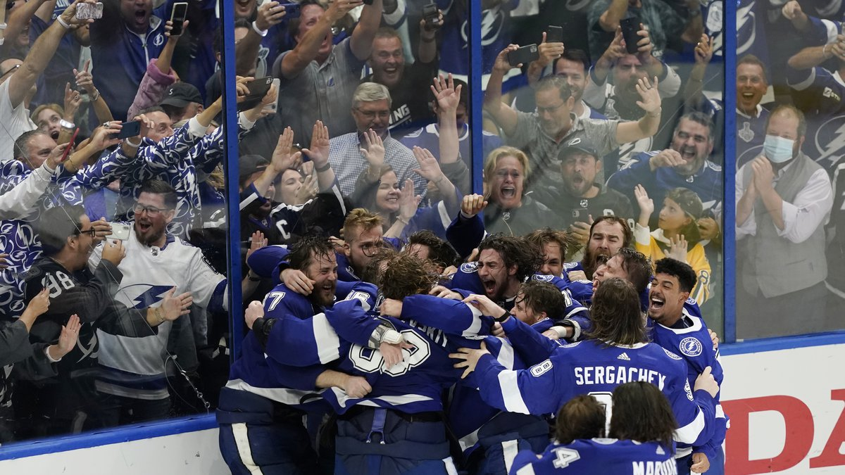 The Tampa Bay Lightning celebrate their series win over the Montreal Canadiens to clinch the...