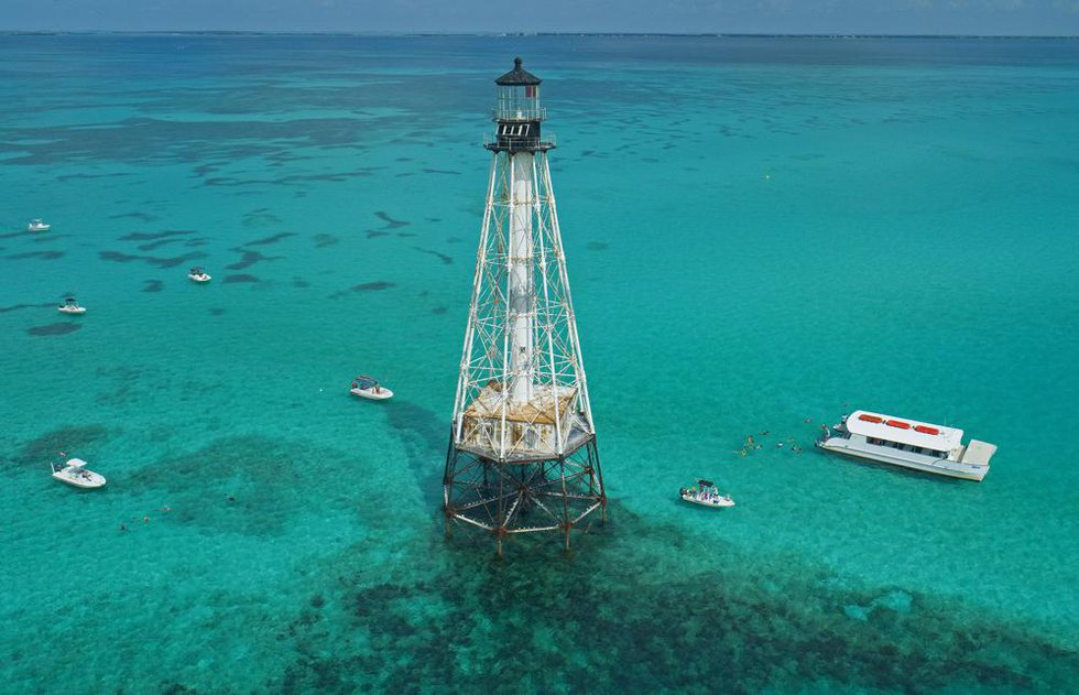 This aerial photo provided by the Florida Keys News Bureau shows boats with snorkelers anchored...
