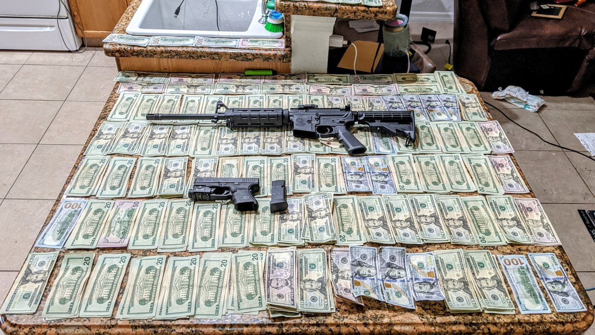 Charlotte County deputies found cash, guns and drugs all within easy reach of young children.