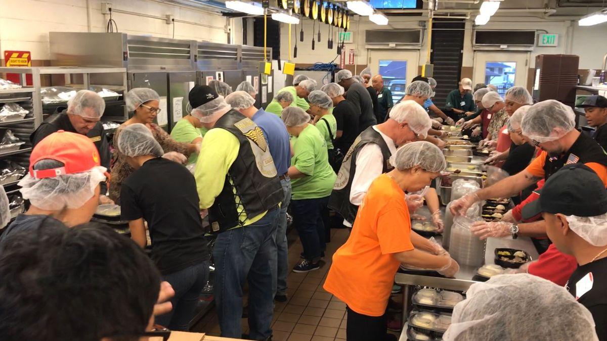 Dozens of volunteers organize meals for seniors on Thanksgiving morning.