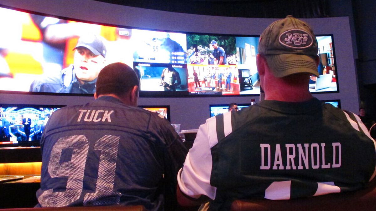 FILE: This Sept. 9, 2018 file photo shows football fans waiting for kickoff in the sports...
