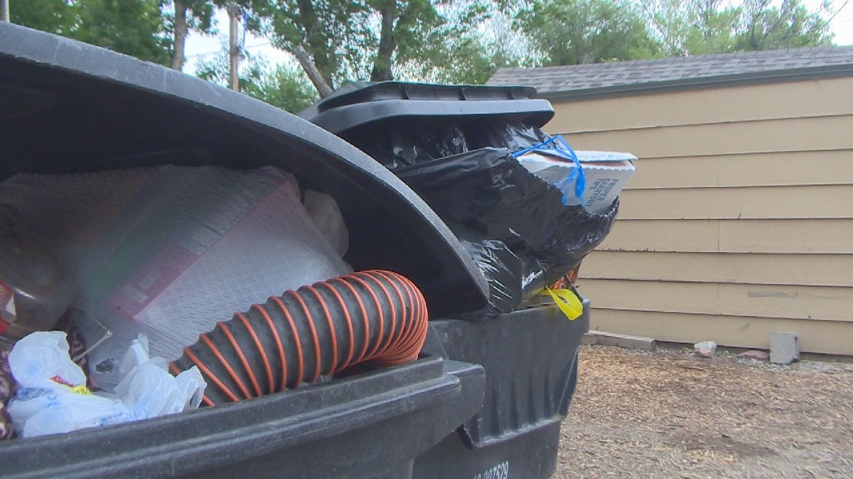 Photo of trash cans overflowing in Colorado Springs 6/17/21.